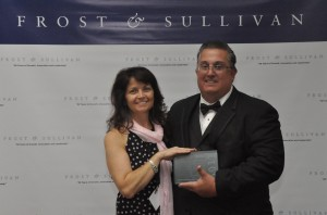Dave and Pauline with the Frost & Sullivan Award for Machine Monitoring